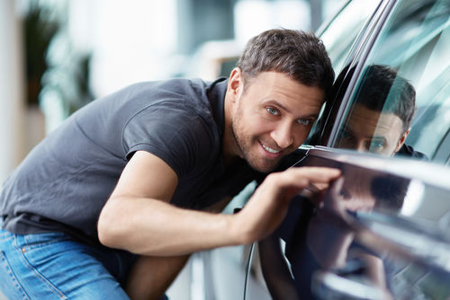 man looking at car from side.jpg
