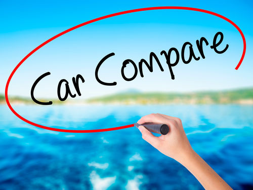 hand writing car compare on window.jpg