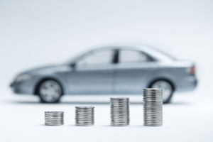 quarters stacking up with car in the background.jpg